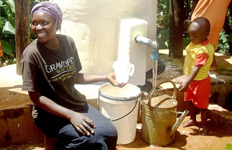 mother-and-child-using-elephant-pump-in-africa-768pxl